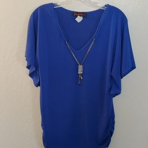 Annabelle Blue Blouse with ornamental necklace